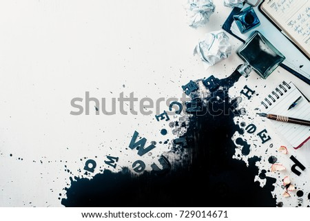 Header with spilled ink, crumpled paper, scattered letters, papers and notepads on a white wooden background. Creative writing concept. Flat lay with copy space. High key still life with an inkwell. #729014671