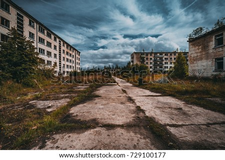 Abandoned ghost town Skrunda, Latvia. Abandoned ex Soviet buildings. Ruins of city. Ex Soviet legacy. World after nuclear war. No humans. Royalty-Free Stock Photo #729100177