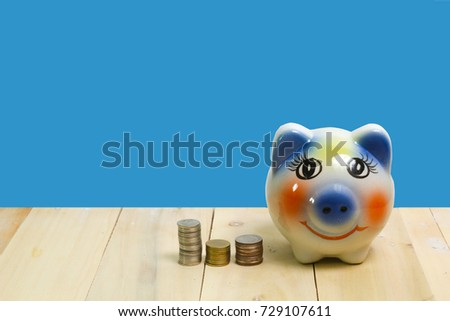 piggy bank and on wood blue background #729107611