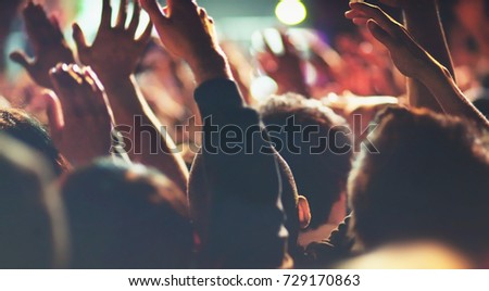 Concert People with Hands Up Excited Attendees Listening to Live Music #729170863