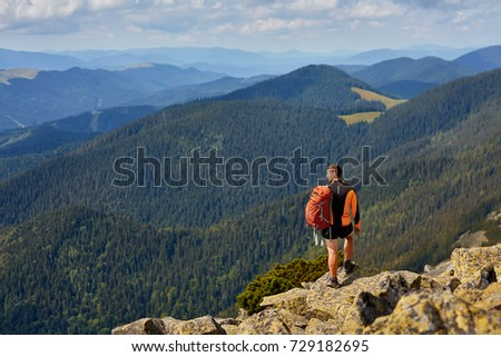 Man traveler with backpack hiking Travel Lifestyle concept adventure active summer vacations outdoor #729182695