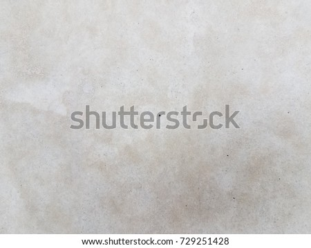 grey cement wall with small hole in it #729251428