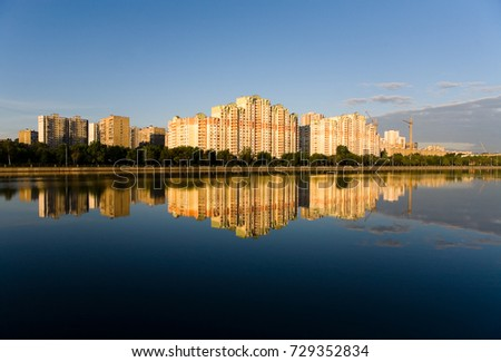 The residential complex is reflected in the Moscow River at dawn. Russia. #729352834