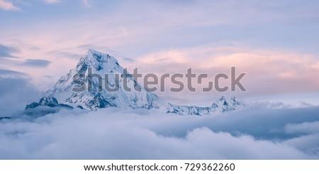himalayan mountain top above the clouds, annapurna, nepal #729362260