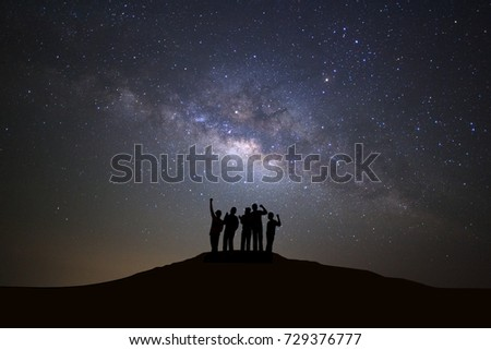 Landscape with milky way galaxy, Starry night sky with stars and silhouette of people standing happy man on high mountain. #729376777