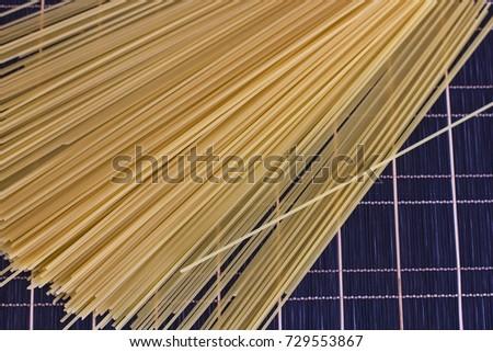 Raw spaghetti on a checkered dark table #729553867