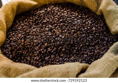 Coffee beans in sacks #729592123