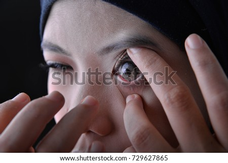 Woman use and show his contact lens design #729627865