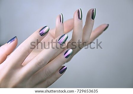 Stylish trendy female mirror manicure. Metal Nail Art. Chrome Nails.