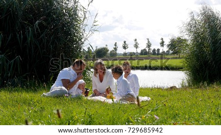 Family doing a picnic on the lawn #729685942