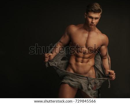 Muscular naked man tearing off his shirt #729845566