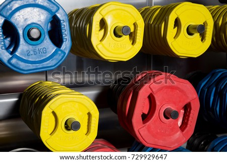 dumbbells of different weight. Color discs of different weight. hand dumbbells #729929647