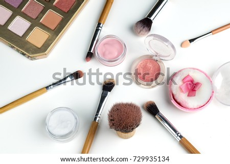 beauty concept : cosmetics top view on a white table. Workplace, cosmetic bag. #729935134