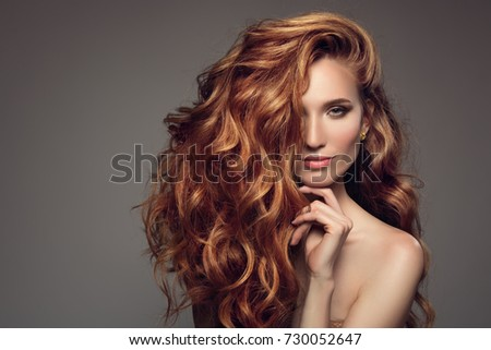 Portrait of woman with long curly beautiful ginger hair.  #730052647