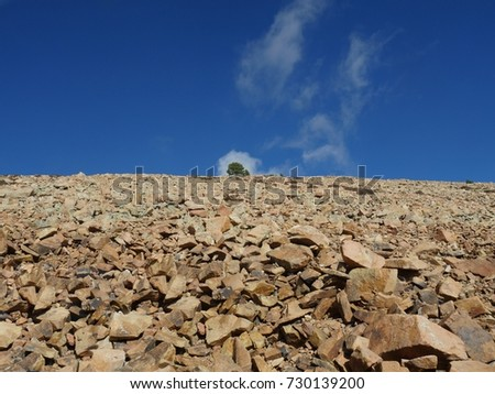 Rocks partially covered with snow in October, with s glimpse of blue skies above on the way to the summit of Pikes Peak, Colorado  #730139200