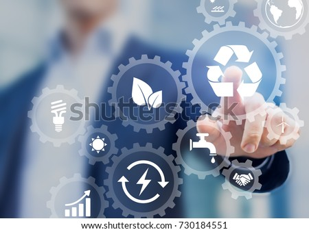Sustainable development concept on screen with icons of renewable energy, natural resources preservation, environment protection inside connected gears, business person in background Royalty-Free Stock Photo #730184551