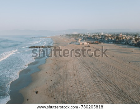 Fresh sunrise morning at the Venice beach in Los Angeles. Aerial view from above. USA #730205818