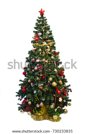 Christmas Happy funny twin brothers sisters dressing up a Christmas tree. Isolated on white