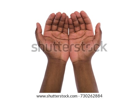Two hand holding or offering something, isolated on white background. Open black male palms, handful gesture #730262884