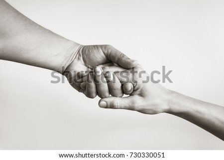 Lending a helping hand. Solidarity, compassion, and charity. Royalty-Free Stock Photo #730330051