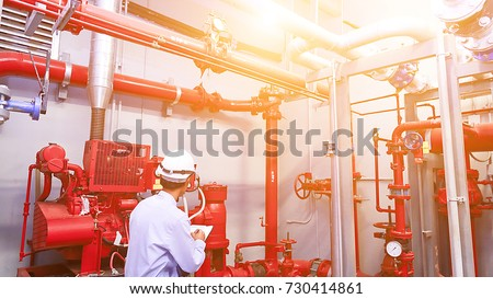 Engineer check red generator pump for water sprinkler piping and fire alarm control system. #730414861
