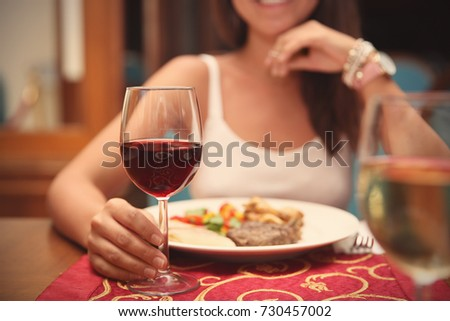 Woman drinking red wine in restaurant #730457002