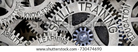 Macro photo of tooth wheel mechanism with SKILL TRAINING, EDUCATION, LEARNING, ABILITY, KNOWLEDGE and COMPETENCE words imprinted on metal surface #730474690