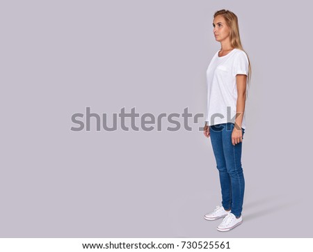 full length of a casual pretty girl. Isolated on grey background #730525561