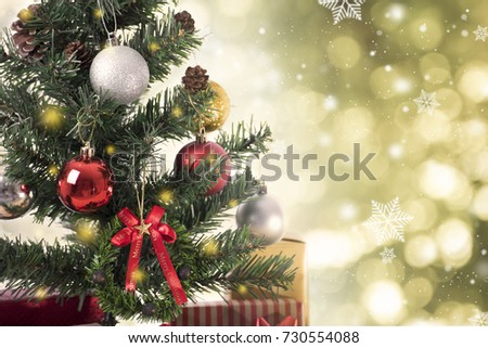 Christmas tree with decorations and snowflake on gold bokeh background. for Happy New Year 2018  #730554088