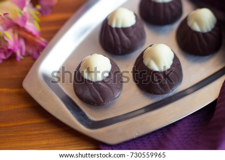 Chocolate sweets on a silver tray. Dessert for breakfast #730559965