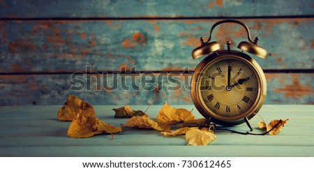 Autumn Time Change, Autumn Leaves and Alarm Clock. #730612465