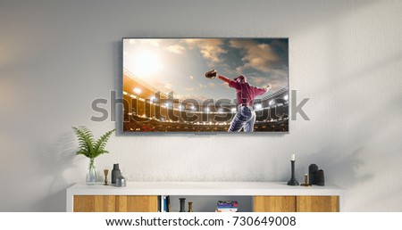3D illustration of a living room led tv on white wall with wooden table and plant in pot showing baseball game moment . #730649008