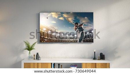 3D illustration of a living room led tv on white wall with wooden table and plant in pot showing baseball game moment . #730649044