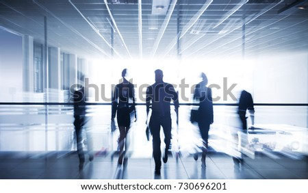 moving silhouettes of businesspeople interacting office background #730696201