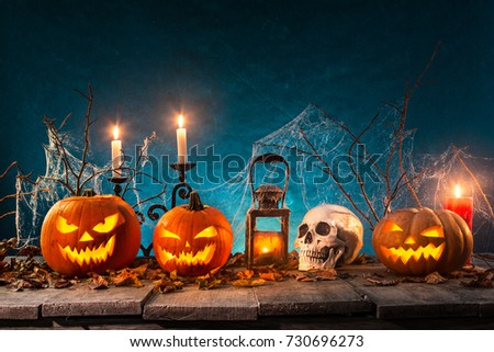 Spooky Halloween pumpkins on wooden planks with spooky background. #730696273