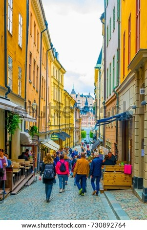 STOCKHOLM, SWEDEN, AUGUST 19, 2016: People are strolling on a street in the Gamla Stan district in central Stockholm, Sweden. #730892764