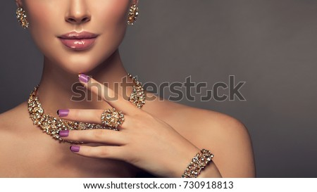 Beautiful girl with jewelry . A set of jewelry for woman ,necklace ,earrings and bracelet. Beauty and accessories. Royalty-Free Stock Photo #730918813
