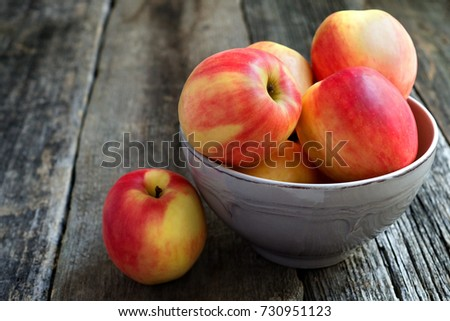 Apples in a bowl on a wooden background #730951123