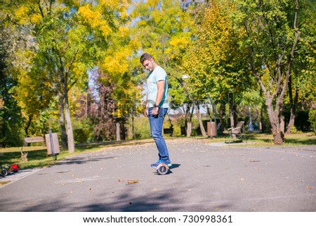 BUCHAREST, ROMANIA, - October 9, 2017: Using Electric Hoverboard on the park in a sunny day with bokeh effect and blurry. Illustrative editorial content. #730998361