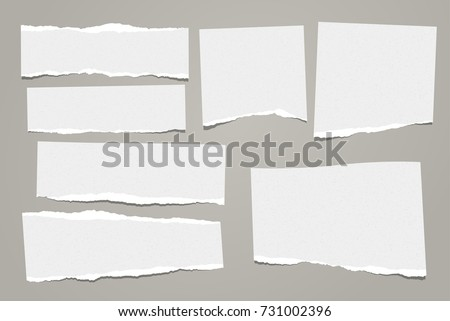 White ripped note, notebook paper stuck with sticky tape on black background. Royalty-Free Stock Photo #731002396