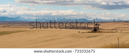 Oil well with a mountain range in the background