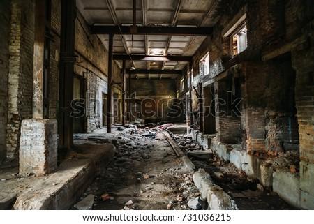 Dark scary corridor in abandoned industrial ruined brick factory, creepy interior, perspective toned #731036215