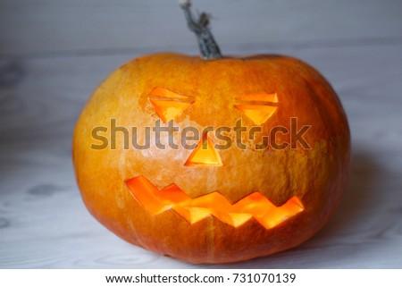 Halloween pumpkin head jack lantern on wooden background #731070139