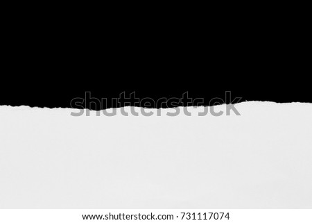sheet of torn paper on black background with copy space #731117074