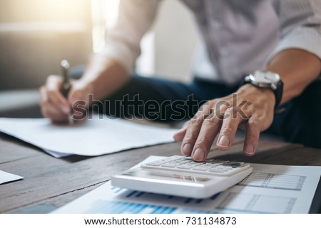 Business Financing Accounting Banking Concept, businessman doing finances and calculate about cost to real estate investment and in other, tax system. Royalty-Free Stock Photo #731134873