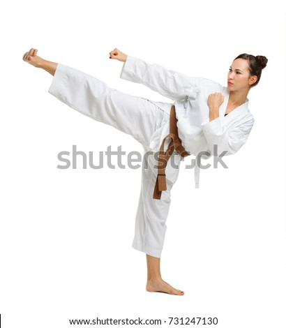 Girl in karate uniform on isolated white background #731247130