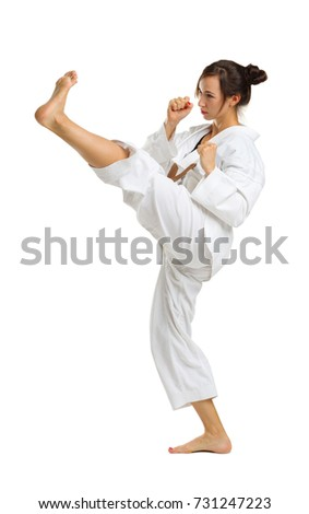 Girl in karate uniform on isolated white background #731247223