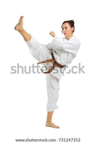 Girl in karate uniform on isolated white background #731247352
