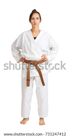 Girl in karate uniform on isolated white background #731247412