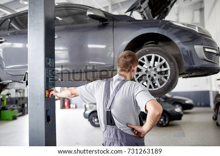 Cars, raised on a car lift in a car service. #731263189